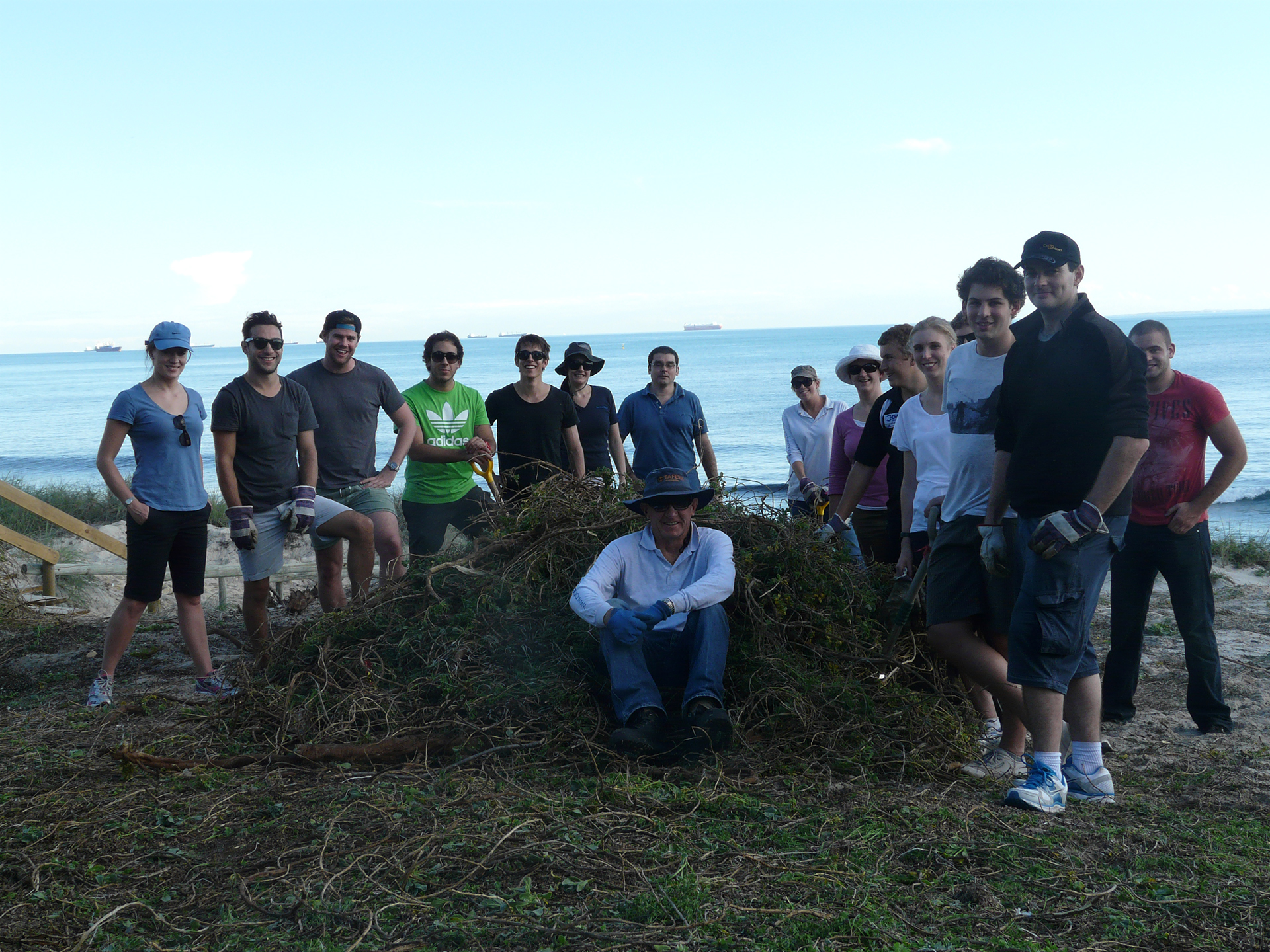 Malcolm in the foreground - volunteers removed a huge pile of weeds before planting commenced