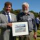Mayor Kevin Morgan presenting Mike Ewing's award